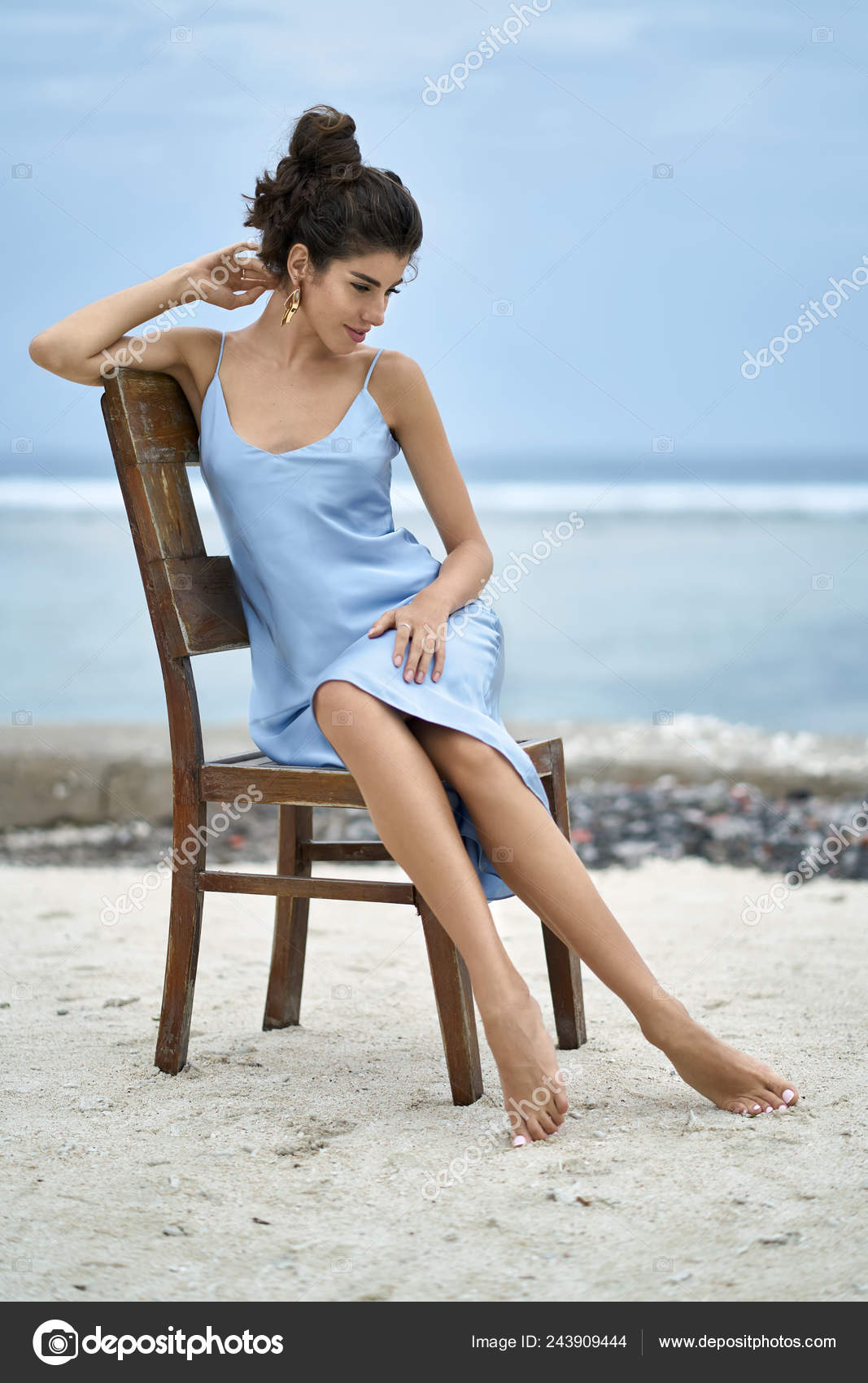 Brunette Woman In Blue Dress Posing On Chair On Sand Beach Stock Photo Image By C Bezikus 243909444