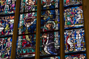MUNICH, GERMANY - NOVEMBER 25, 2018 : Ancient stained glass windows on a religious theme in the Cathedral of the Blessed Virgin Mary in Munich Germany.