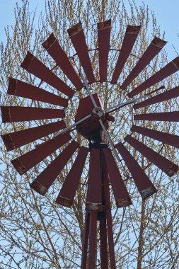 steel windmill drawing water