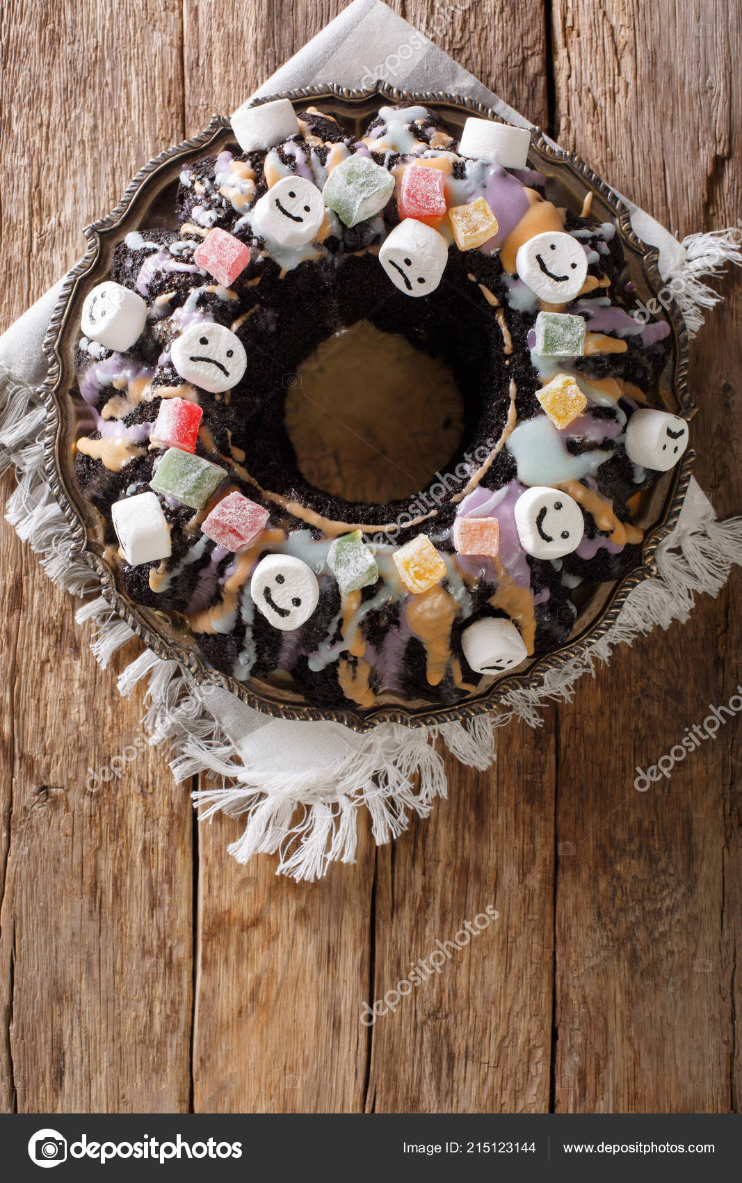 halloween black bundt cake decorated candied fruits marshmallow