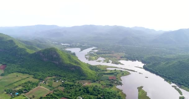 Aerial view of Khwae Yai river, Tha Thung Na dam Kanchanaburi, Thailand. Water flow from Srinagarind Dam to generate electricity from water. surround with nature , homestay and small town.