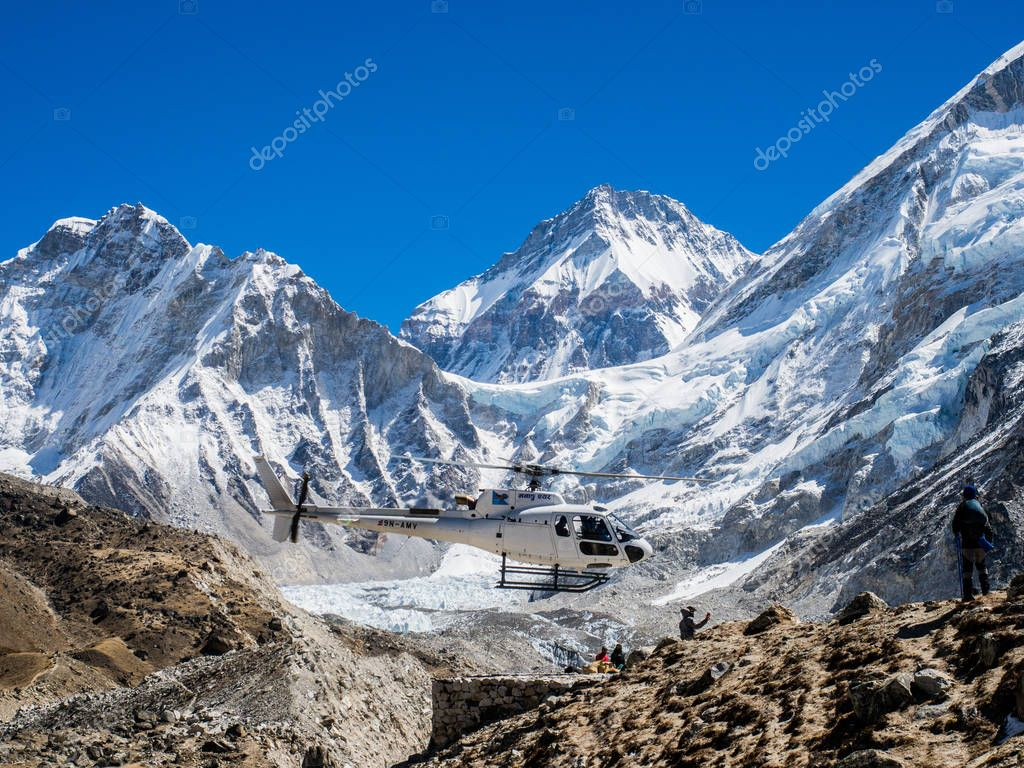 Lobuche, Nepal 04/16/2018 : Rescued Helicopter with the beatiful snow capped mountain as a background