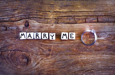 Will you marry me? An offer of marriage on rustic background. Wording