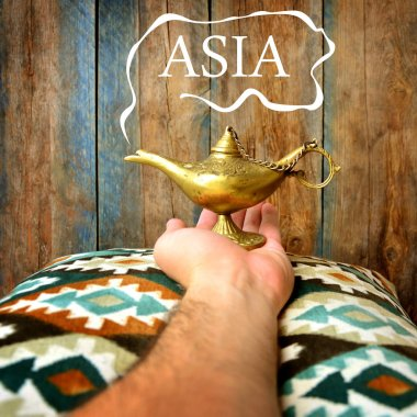 Magic Asia concept with Lamp of wishes in a hand and