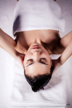 top view close up portrait of Asian female lying on bed after doing facials