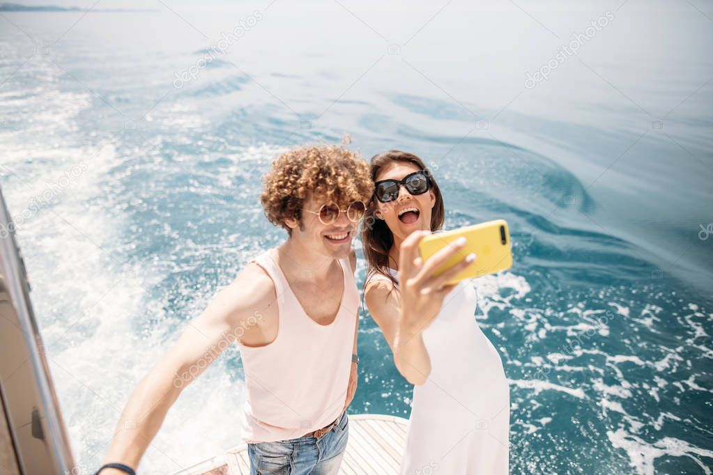 Happy caucasian couple taking selfie traveling on vacation