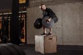pleasant bodybuilder is afraid of jumping on the floor