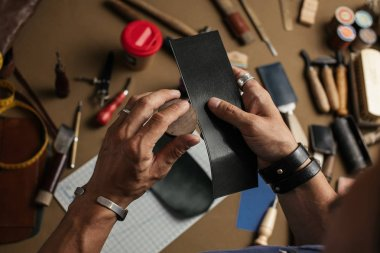 Working process of producing hand made leather wallet in the leather workshop.