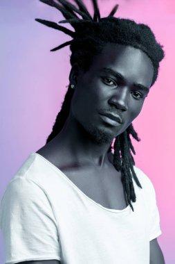 African Man Portrait Under Blue And Purple Lights - Ultraviolet
