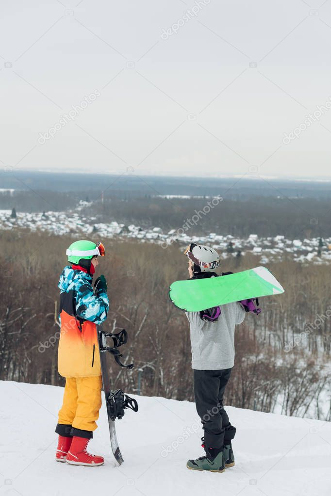two ambitious snowboarders sharing with experiense outdoors