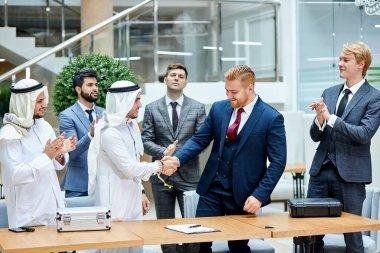 Sheikh make business deal with caucasian businessman. Business concept