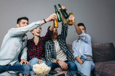 happy friends are watching sport program