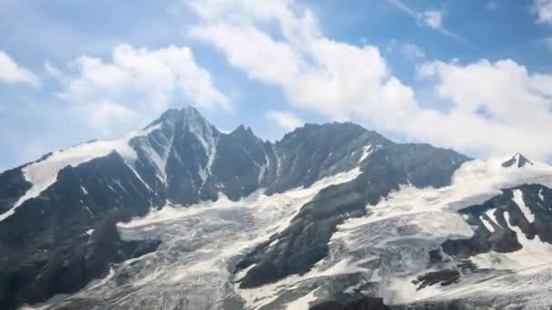 Time lapse of the Grossglockner, with the altitude of 3798 metres, the highest mountain in Austria. With the shadows from the motion of the clouds, the frozen glacier comes to life.