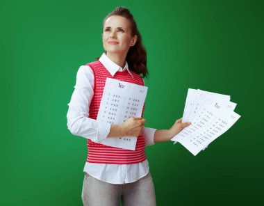 learner woman showing A+ test result in one hand and several F e