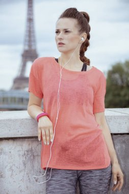woman jogger looking into the distance and listening to the musi