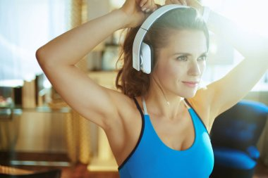 sports woman listening to the music with headphones
