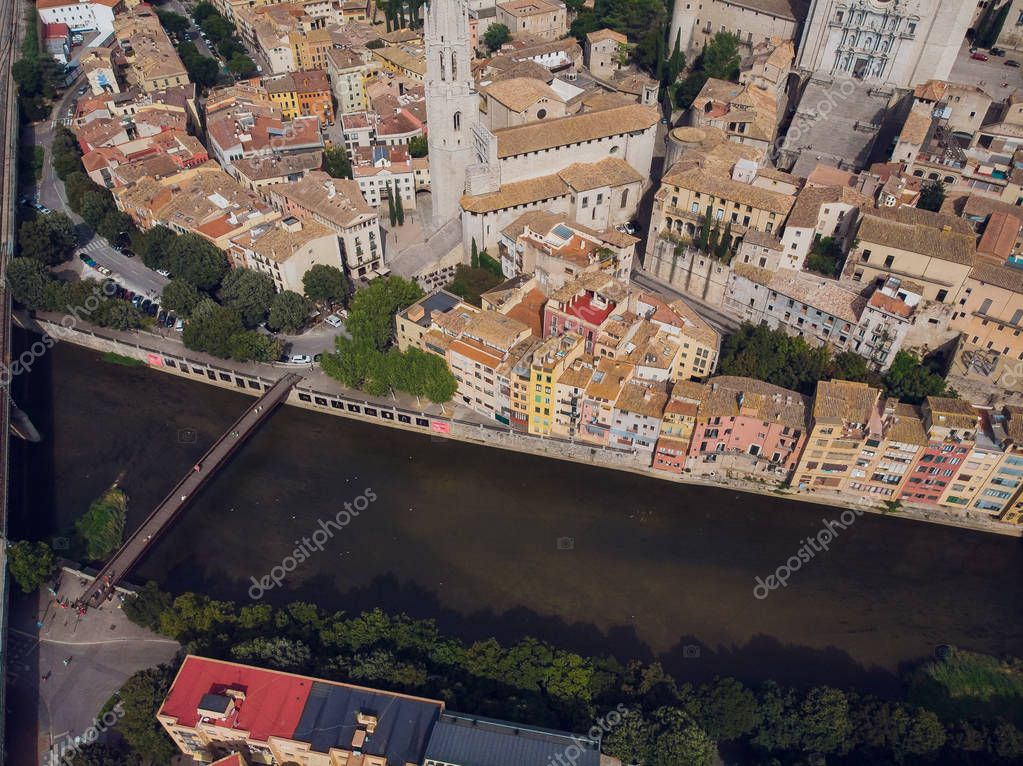 Girona - town in Catalonia, Spain. Onyar River bridge, colorful mediterranean architecture. Prominent cathedral