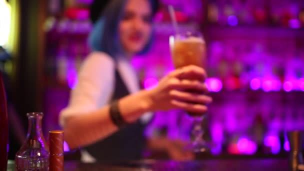 Handsome barman professional posh bar making cocktail drinks