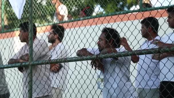Maldives, Maldives - 12 05 2018: Unidentified men watch soccer match between Soccer is popular. football fans.