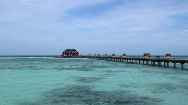Over water bungalows with steps into amazing green lagoon.