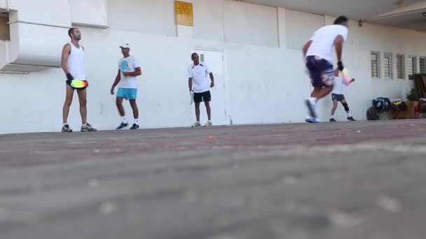 TEL AVIVI ISRAEL 04 09 2018: man kneads on the sports ground before the competition with the partner in the squash game. corporate sport. mobile game with racket and ball.