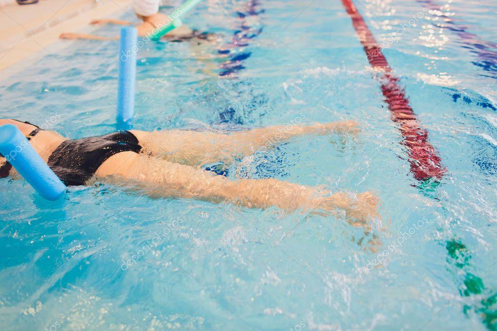 women trains in aqua aerobics, learn to swim.