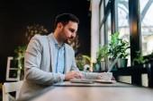 Entrepreneur working on laptop in restaurant.