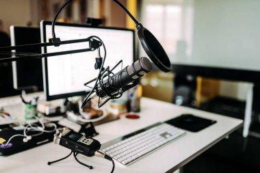 Microphone over desk in radio studio.