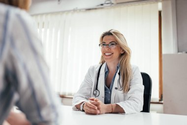 Smiling female doctor with a patient in the office.