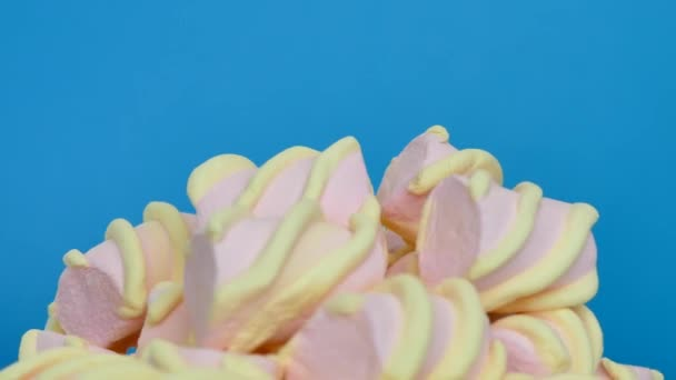 Delicious dessert of marshmallow. Pastel colors on a blue background.