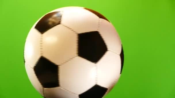 A futball-labda forog egy zöld háttér. Sport játék Soker. Bajnokok Ligája. Labdarúgó-világbajnokság. Cél, hogy a kapu.