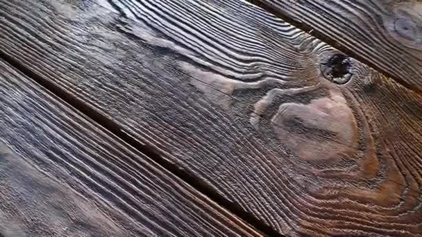Textura je dřevěná deska. Starý dřevěný stůl. Staré relikvie. Tmavé pozadí.