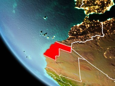 Western Sahara from orbit of planet Earth at night with highly detailed surface textures with visible border lines and city lights. 3D illustration. Elements of this image furnished by NASA.