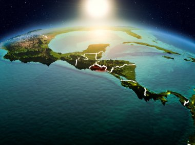Sunrise above El Salvador highlighted in red on model of planet Earth in space with visible country borders. 3D illustration. Elements of this image furnished by NASA.