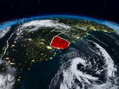 Uruguay from space at night on Earth with visible country borders. 3D illustration. Elements of this image furnished by NASA.