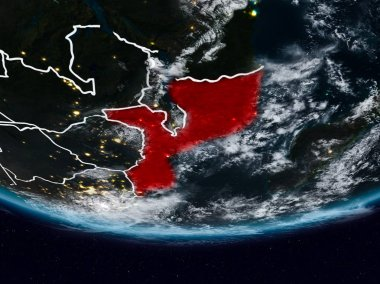 Mozambique on Earth at night with visible country borders. 3D illustration. Elements of this image furnished by NASA.