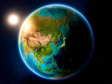 Sunset above North Korea highlighted in red on planet Earth with visible country borders. 3D illustration. Elements of this image furnished by NASA.
