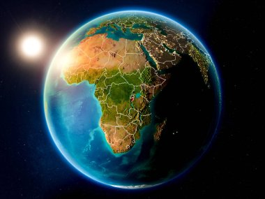 Sunset above Burundi highlighted in red on planet Earth with visible country borders. 3D illustration. Elements of this image furnished by NASA.