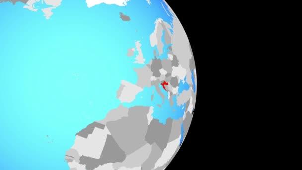 Closing in on Croatia on simple political globe. 3D illustration.