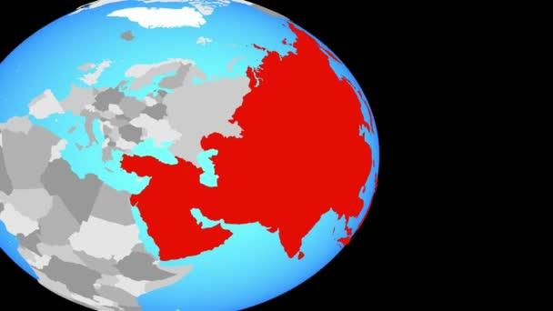 Zavírat v Asii na jednoduché politické globe. 3D obrázek.