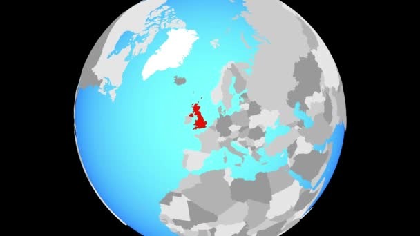 Zoom to United Kingdom on blue political globe. 3D illustration.