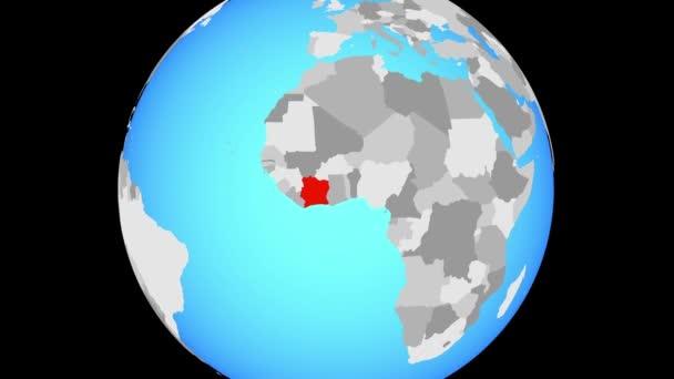 Zoom to Ivory Coast on blue political globe. 3D illustration.