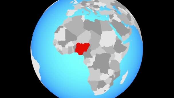 Zoom to Nigeria on blue political globe. 3D illustration.