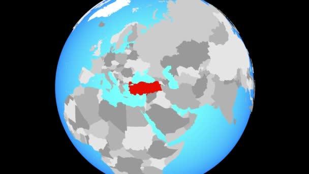 Zoom to Turkey on blue political globe. 3D illustration.