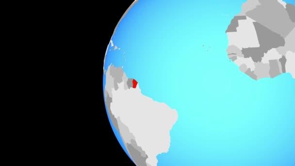 Francouzská Guyana na modré politické globe. Obíhající kolem zeměkoule a přiblížení k zemi. 3D obrázek