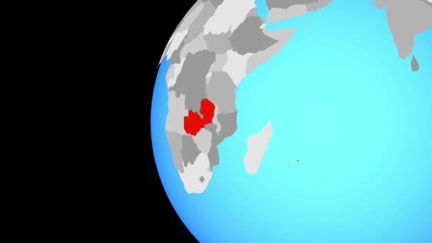 Zambie na modré politické globe. Obíhající kolem zeměkoule a přiblížení k zemi. 3D obrázek