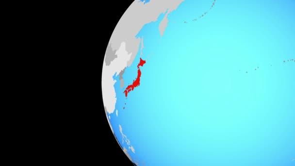Japonsko na modré politické globe. Obíhající kolem zeměkoule a přiblížení k zemi. 3D obrázek.