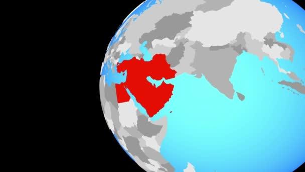 Blízký východ na modré politické zeměkoule. Obíhající kolem zeměkoule a přiblížení k zemi. 3D obrázek