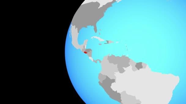 El Salvador na modré politické globe. Obíhající kolem zeměkoule a přiblížení k zemi. 3D obrázek