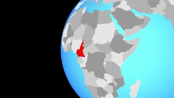 Kamerun na modré politické globe. Obíhající kolem zeměkoule a přiblížení k zemi. 3D obrázek